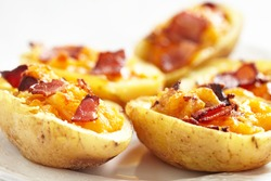 Potato skin with bacon and cheese