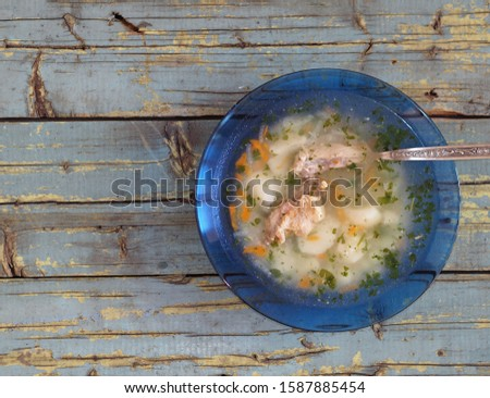 Potato soup with meat on a blue rustic rustic table background