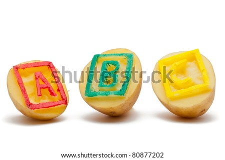 Potato stamps with ABC letters - back to school or learning concept