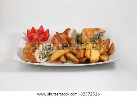 potato with loaded meat on white plate isolated on white background