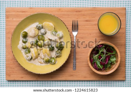 Potatoes and Brussels Sprouts with Creamy Vegan Cheese Sauce #1224615823