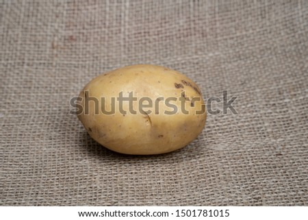 Potatoes. Fresh potatoes. Potatoes on a jute bag with natural product appearance for product food photography