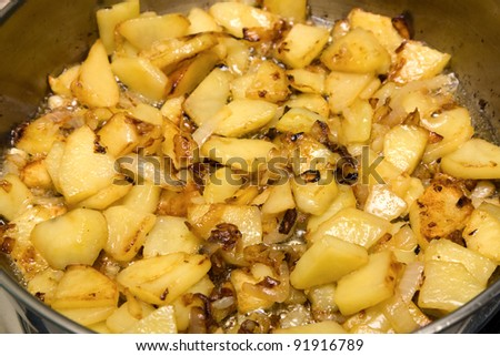 Potatoes fried in a skillet