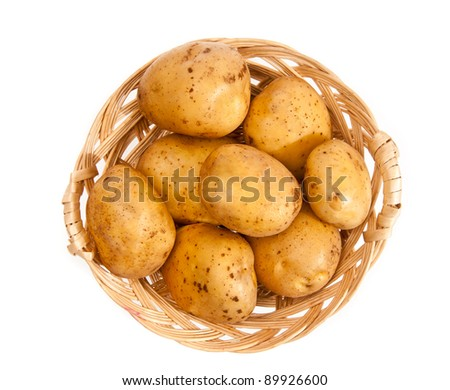 Potatoes in a wicker basket isolated on white background