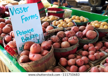 Potatoes in baskets at market