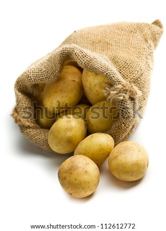 potatoes in burlap sack on white background