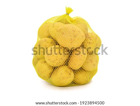 Potatoes in mesh sack isolated on white background Stock photo ©