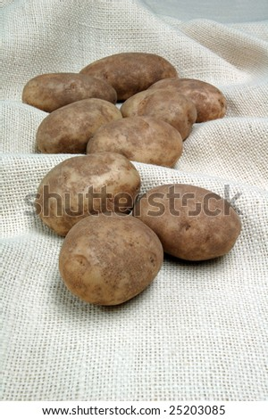 Potatoes on burlap background