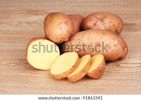 Potatoes on wooden background