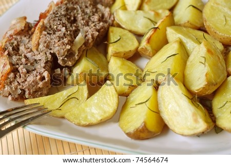 Potatoes roasted with rosemary and meatloaf
