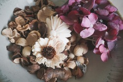 potpourri. aromatic dried flowers in the bowl. Vintage film grained filter.