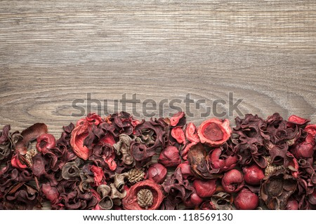 Potpourri. Close-up of dried flowers, used for aromatherapy, over wooden background. Top view.