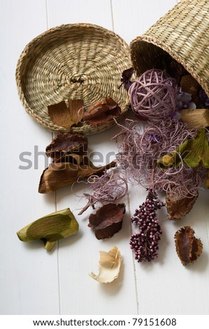 potpourri on a white table from a basket - stock photo