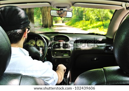 Potrait of a man driving a car without safety belt