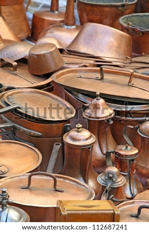 pots pans and ancient copper pots - stock photo