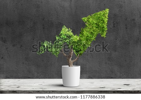 Potted green plant grows up in arrow shape over dark background. Concept business image #1177886338