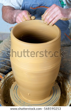 Potter Making Vase Of Fresh Clay In The Pottery Workshop On The