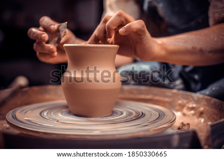 Potter's wheel and the hands of an artisan. Close-up. Stock fotó ©