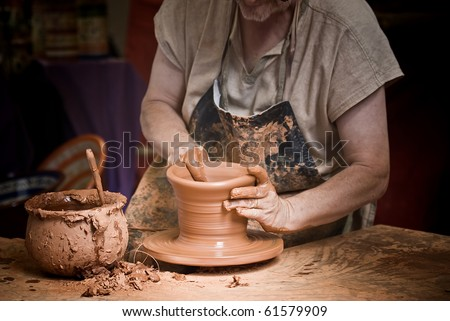 Potter working at his workshop.
