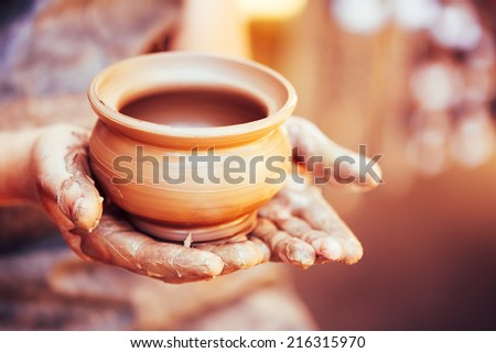 Shutterstock Pottery Craft Ceramic Clay In Potter Human Hand. Toned Instant Photo