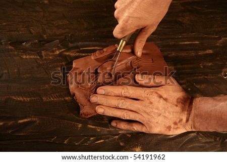 pottery craftsmanship potter craftsman hands working red clay