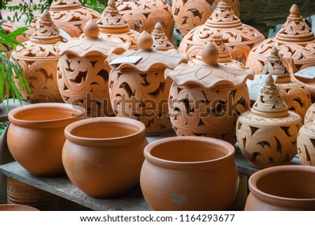 Pottery for sell with normal jar style and with lid style #1164293677