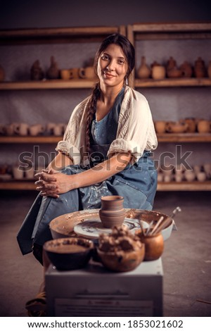 Pottery master demonstrates a finished clay bowl in the workshop  . Making pottery. Stock fotó ©