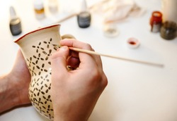 Pottery. Painting pottery.