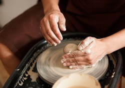 Pottery workshop. the art of hand made.The hands of the master are molded from clay. Potter's wheel and clay products