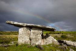 Poulnabrone Dolmen, Clare, Ireland, with rainbow sky