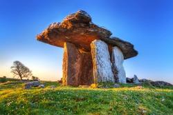 Poulnabrone portal tomb in Burren at sunrise, Ireland