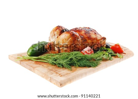 poultry : fresh grilled whole chicken with black olives and raw tomatoes on wooden board isolated over white background