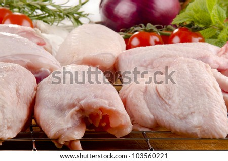 poultry parts before preparation and vegetable