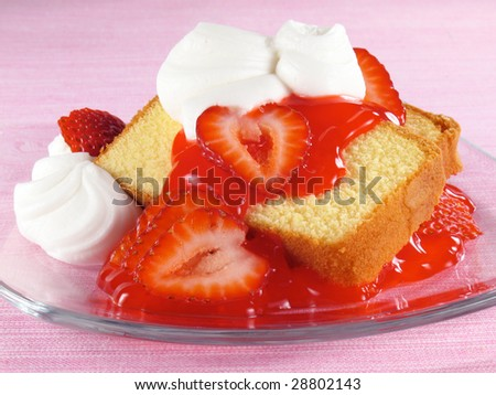 Pound cake with strawberries, strawberry glaze, and whipped cream.