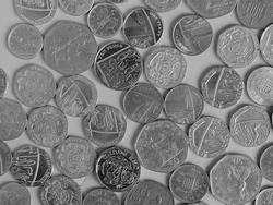 Pound coins money (GBP), currency of United Kingdom, over background in black and white