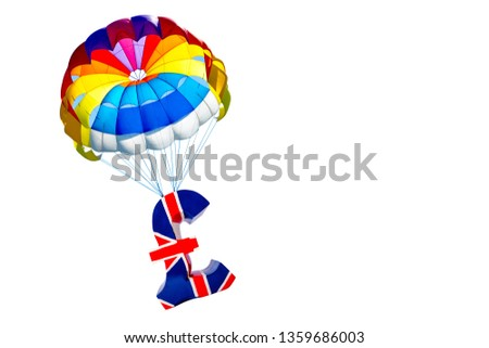 Pound of sterling symbol of British currency lifting by parachute on white background, isolated. #1359686003