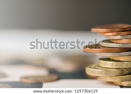 Pound sterling coins stacking on chess table with black background.Currency exchange concept.-Image. #1297306129