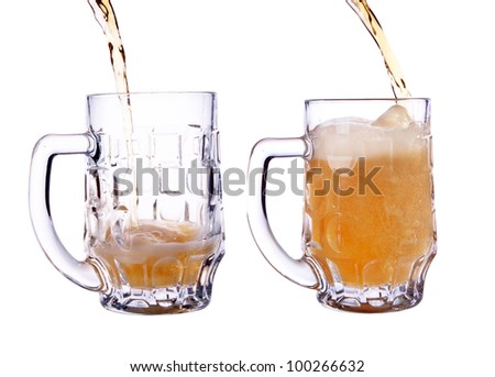 pour a glass of beer. shot on a white background