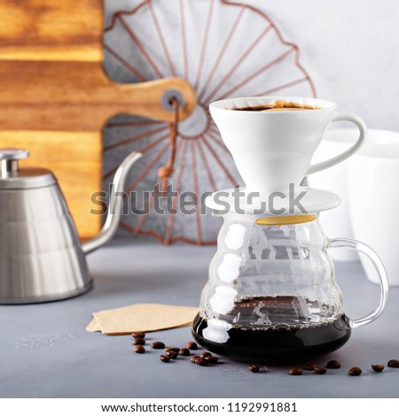 Pour over coffee being made with a kettle and glass carafe
