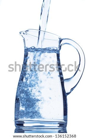 pour water in a carafe, symbol photo for drinking water, refreshments, supplies and consumables