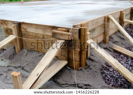 poured cement foundation for the construction of the cottage, wooden formwork Stock photo ©