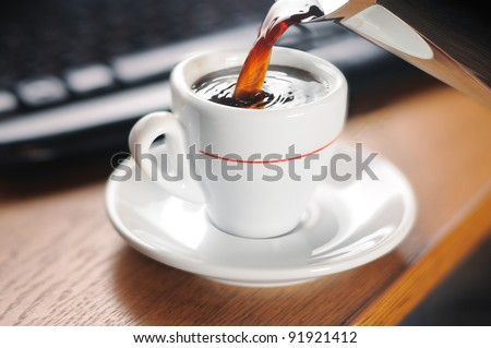 Pouring a cup of hot coffee. Selective focus