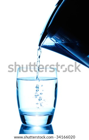 Pouring a glass of purified water isolated on white. Elegant blue pitcher, nice stream and bubbles - stock photo