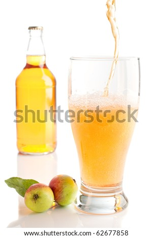 Pouring a glass of scrumpy cyder on white background
