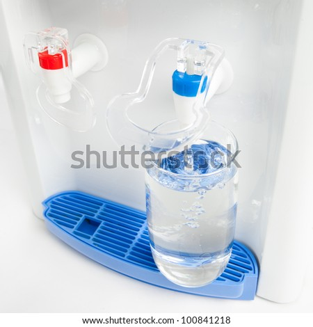 pouring a glass of water from dispenser