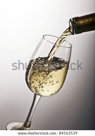Pouring a glass of white wine - stock photo