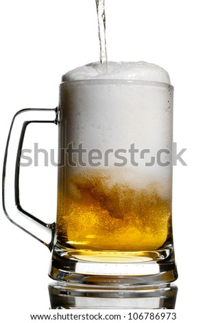 Pouring a light beer in a transparent keg isolated on white