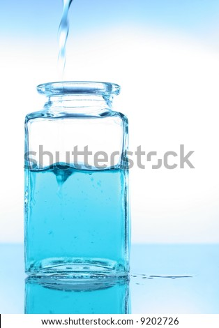 Pouring a liquid into a glass container