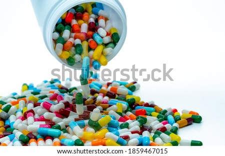 Pouring antibiotic capsule out of plastic bottle. Antibiotic drug resistance concept. Antibiotic drug overuse and smart use concept. Pharmaceutical industry. Pharmacy product. Prescription drugs.