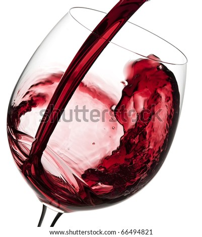 Pouring Australian red wine into the wine glass  isolated on white background